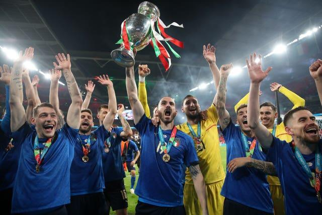 Italy's Leonardo Bonucci celebrates with the trophy after his side's victory