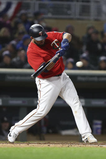 Minnesota Twins' Juan Graterol hits the ball against the Chicago White Sox in the second game of a baseball doubleheader Friday, Sept. 28, 2018, in Minneapolis. (AP Photo/Stacy Bengs)