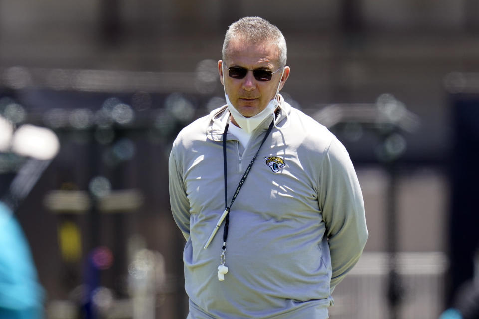 Jacksonville Jaguars head coach Urban Meyer watches players run drills during NFL football rookie minicamp, Saturday, May 15, 2021, in Jacksonville, Fla. (AP Photo/John Raoux)