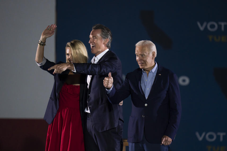 President Joe Biden, right, gives a thumb up as California Gov. Gavin Newsom, and wife, Jennifer Siebel Newsom, wave to their supporters at a rally ahead of the California gubernatorial recall election Monday, Sept. 13, 2021, in Long Beach, Calif. (AP Photo/Jae C. Hong)