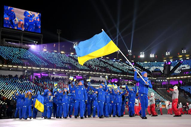 <p>Flag bearer of The Ukraine Olena Pidhrushna and teammates enter the stadium during the Opening Ceremony of the PyeongChang 2018 Winter Olympic Games at PyeongChang Olympic Stadium on February 9, 2018 in Pyeongchang-gun, South Korea. (Photo by Matthias Hangst/Getty Images) </p>