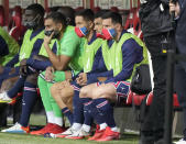 PSG's Lionel Messi, right, sits on the bench prior to the France League One soccer match between Reims and Paris Saint-Germain, at the Stade Auguste-Delaune in Reims, France, Sunday, Aug. 29, 2021. (AP Photo/Francois Mori)
