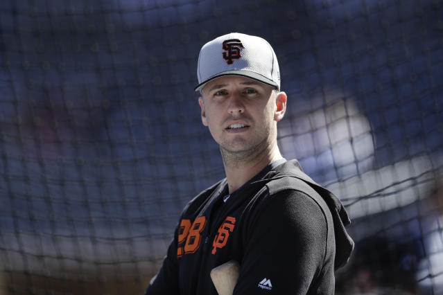 San Francisco Giants catcher Buster Posey warms up before a baseball game against the San Diego Padres, Thursday, March 28, 2019, in San Diego. (AP Photo/Gregory Bull)