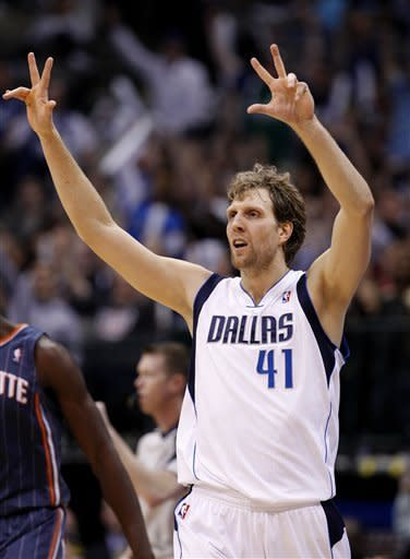 Dallas Mavericks' Dirk Nowitzki (41), of Germany, gestures after sinking a three-point basket in the second half of an NBA basketball game against the Charlotte Bobcats, Thursday, March 15, 2012, in Dallas. The Mavericks won 101-96. (AP Photo/Tony Gutierrez)