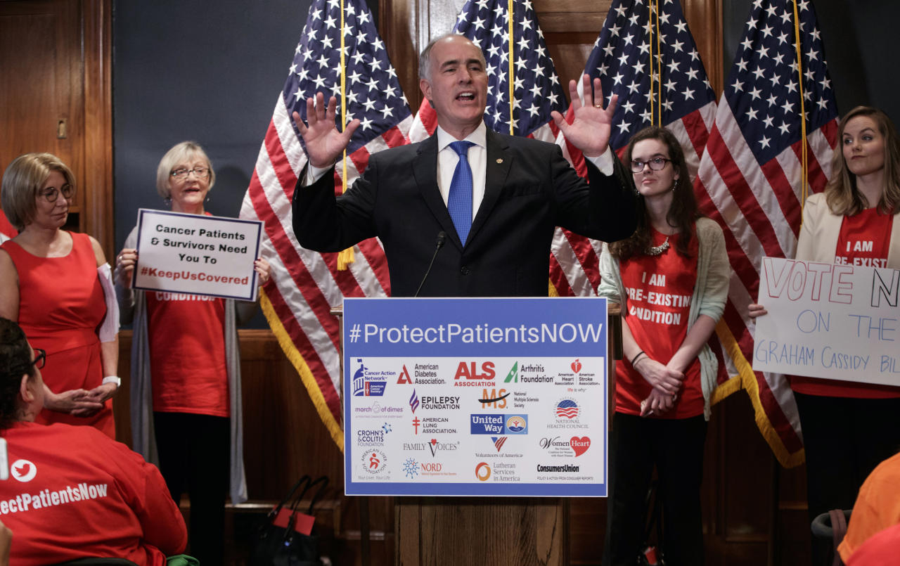 Sen. Bob Casey, D-Pa., a member of the Senate Finance Committee, joins activists opposed to the Republican's Graham-Cassidy health care repeal bill, at a news conference on Capitol Hill in Washington, Monday, Sept. 25, 2017. (AP Photo/J. Scott Applewhite)