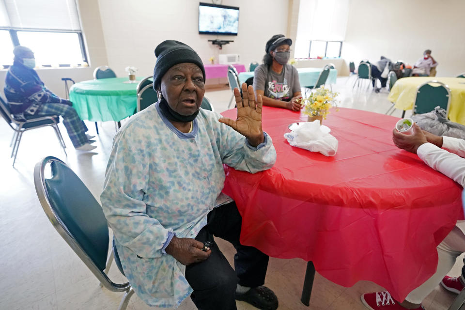 P.M. Browner, 88, speaks about her apprehension over receiving the COVID-19 vaccine, while waiting for a transportation bus at the Rev. S.L.A. Jones Activity Center for the Elderly to take her to receive a vaccination, Wednesday, April 7, 2021, in Clarksdale, Miss. She said she thinks vaccinations will eventually be required, and she wants to be able to continue to socialize at a local senior center. (AP Photo/Rogelio V. Solis)