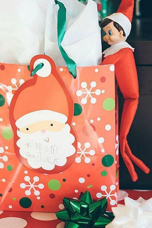 """<p>Who <em>hasn't</em> snuck a peek at their gift a little early? Let him have his fun.</p><p><strong>Get the tutorial at <a href=""""http://snapshotsofasweetlife.blogspot.com/search/label/Elf%20on%20the%20Shelf"""" rel=""""nofollow noopener"""" target=""""_blank"""" data-ylk=""""slk:Snapshots of My Life"""" class=""""link rapid-noclick-resp"""">Snapshots of My Life</a>.</strong></p><p><a class=""""link rapid-noclick-resp"""" href=""""https://go.redirectingat.com?id=74968X1596630&url=https%3A%2F%2Fwww.walmart.com%2Fsearch%2F%3Fquery%3Dchristmas%2Bgift%2Bbags&sref=https%3A%2F%2Fwww.thepioneerwoman.com%2Fholidays-celebrations%2Fg34080491%2Ffunny-elf-on-the-shelf-ideas%2F"""" rel=""""nofollow noopener"""" target=""""_blank"""" data-ylk=""""slk:SHOP CHRISTMAS GIFT BAGS""""><strong>SHOP CHRISTMAS GIFT BAGS</strong></a></p>"""