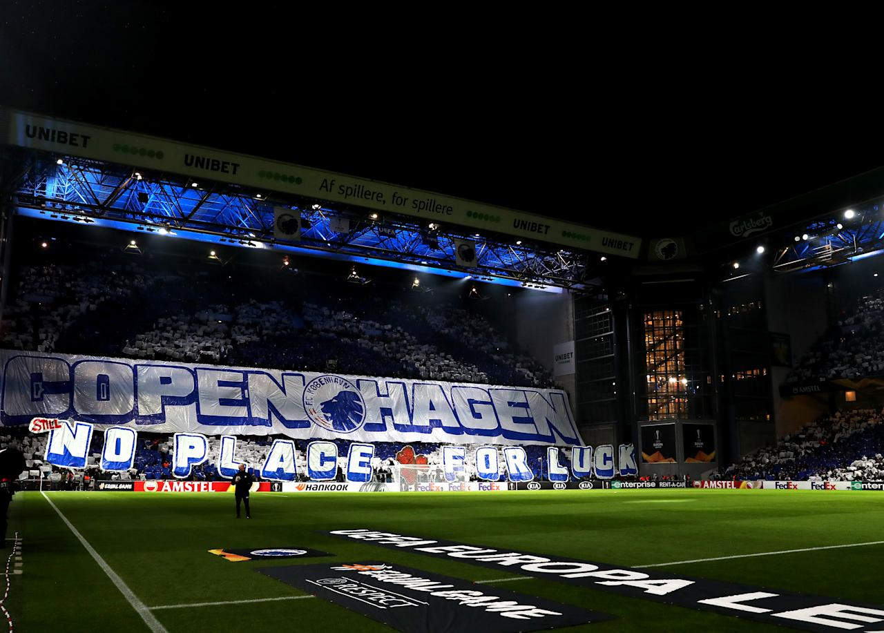 COPENHAGEN, DENMARK - FEBRUARY 20:  FC Kobenhavn fans hold up a tifo display prior to the UEFA Europa League round of 32 first leg match between FC Kobenhavn and Celtic FC at Telia Parken on February 20, 2020 in Copenhagen, Denmark. (Photo by Catherine Ivill/Getty Images)