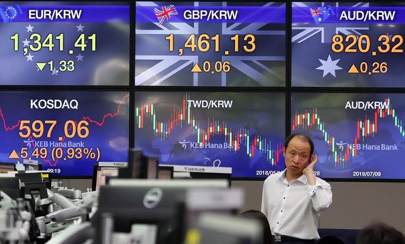 Asian shares rise as investors watch trade war, economies