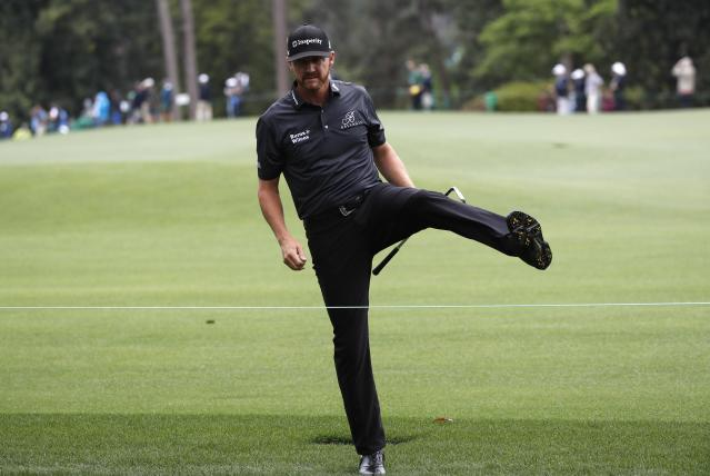 Jimmy Walker of the U.S. crosses back to the first fairway from the 9th after hitting his second shot back to the first hole during third round play of the 2018 Masters golf tournament at the Augusta National Golf Club in Augusta, Georgia, U.S. April 7, 2018. REUTERS/Mike Segar