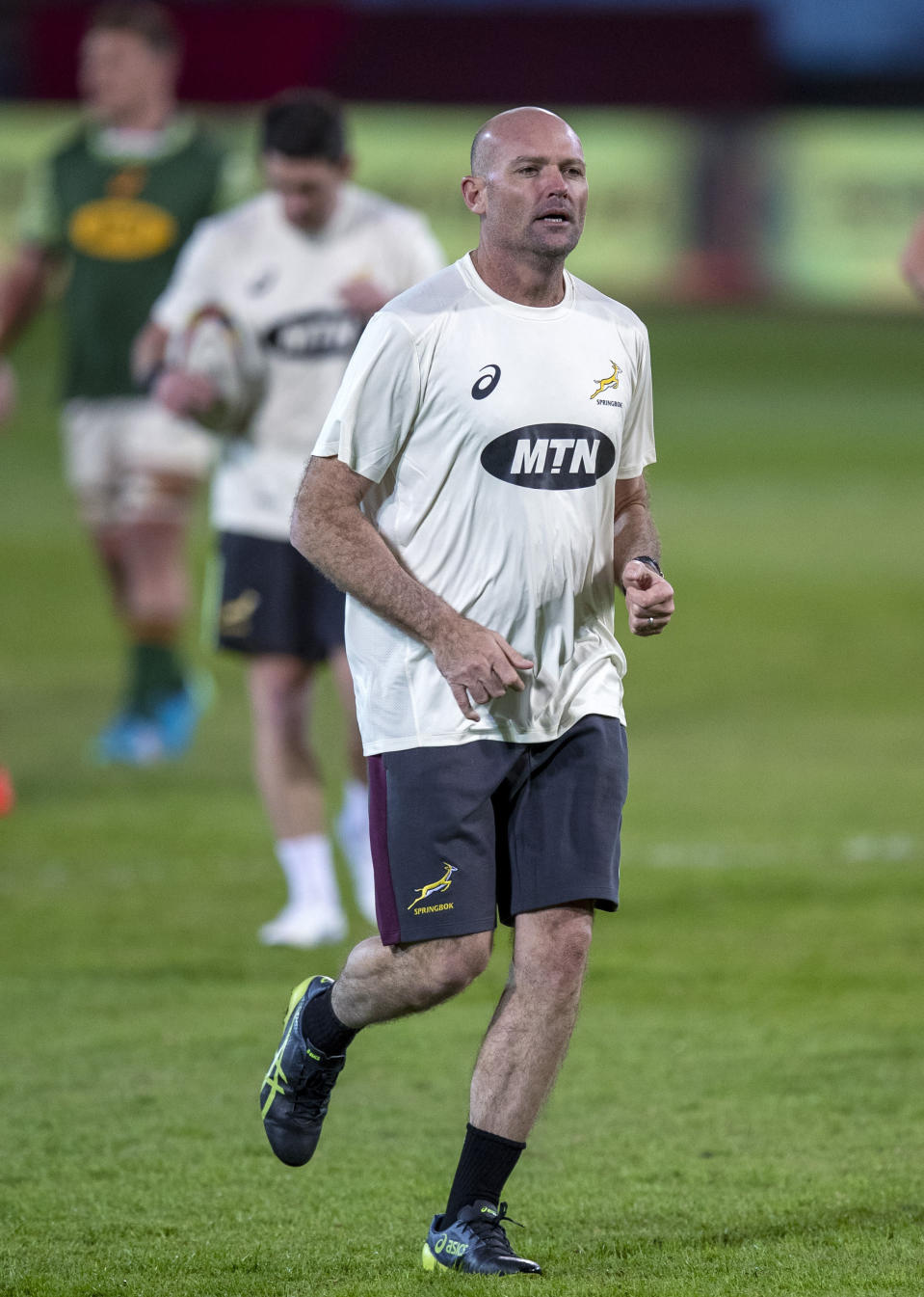 South Africa's head coach Jacques Nienaber runs as his team warms up before the start of the first test rugby match between South Africa and Georgia at Loftus Versfeld in Pretoria, South Africa, Friday, July 2, 2021. (AP Photo/Themba Hadebe)