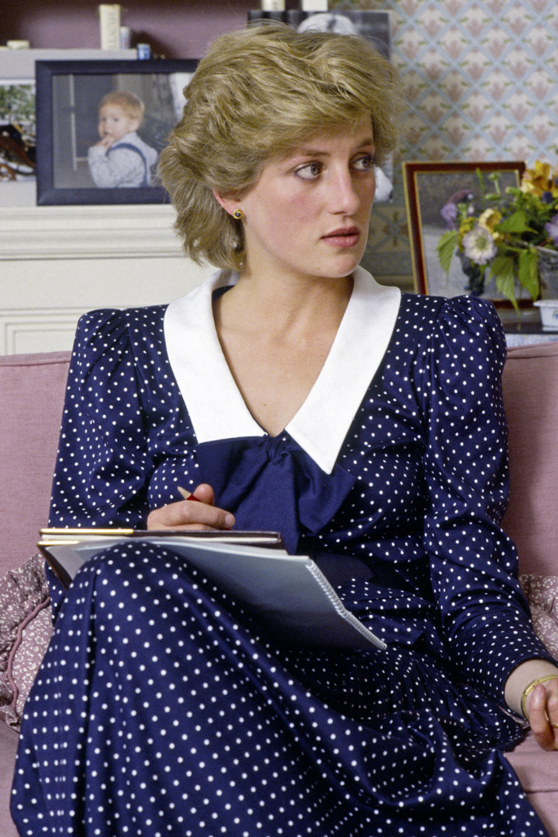 <p>Diana wore a distinct navy and white polka dot dress with a Chelsea collar and bow detail for a photo call at Kensington Palace in October 1985.</p>