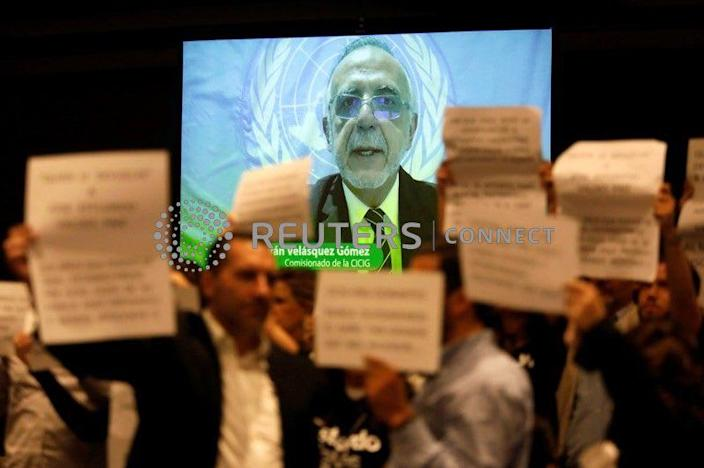 """<div class=""""inline-image__caption""""> <p>""""Ivan Velasquez, Commissioner of the International Commission against Impunity in Guatemala (CICIG) is seen speaking on a screen as people protest against the CICIG's latest report in Guatemala City, Guatemala August 20, 2019. REUTERS/Luis Echeverria""""</p> </div>"""