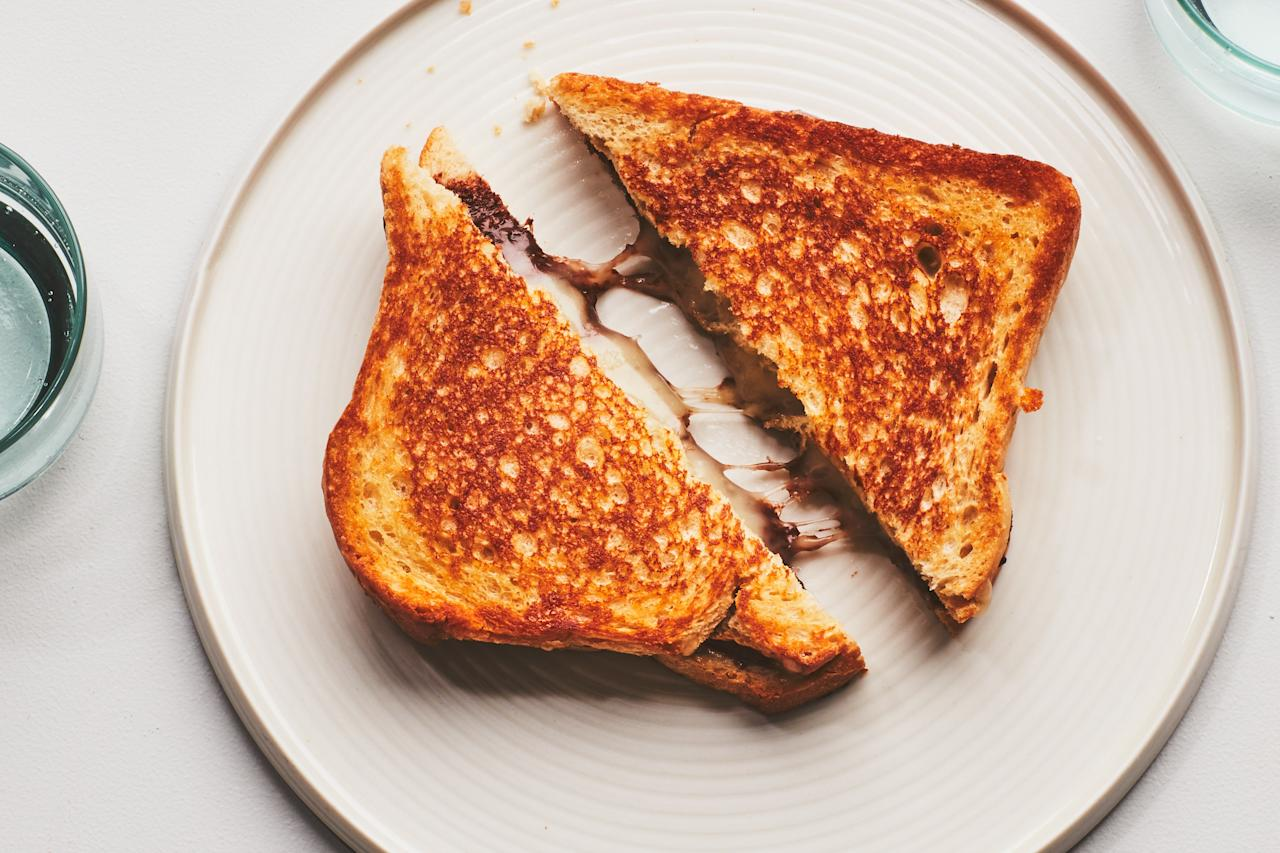 "Though Nutella and cheese may be an unexpected pairing, when melted together into a sandwich it's the ideal sweet-and-savory snack. <a href=""https://www.epicurious.com/recipes/food/views/nutella-grilled-cheese?mbid=synd_yahoo_rss"">See recipe.</a>"