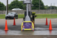 """Safety cones block access to the fuel pumps at this closed Kroger fuel station, Wednesday, May 12, 2021, in Jackson, Miss. State officials warned Tuesday that any shortages seen at individual gas stations are a result of people """"panic buying"""", not the Colonial Pipeline shutdown itself, and call on residents to limit unnecessary travel and only buy as much gasoline as they need. (AP Photo/Rogelio V. Solis)"""