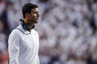 Akron coach Tom Arth walks near the sideline after a score by Auburn during the first half of an NCAA college football game Saturday, Sept. 4, 2021, in Auburn, Ala. (AP Photo/Butch Dill)