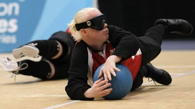 Amy Kneebone Burk, Paralympian goalball athlete, will compete in her fourth Games later this summer.  (Sang Tan/AP - image credit)