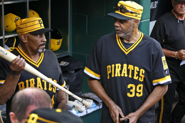 Members of the 1979 Pittsburgh Pirates World Championship team Dave Parker (39) and Mike Easler, left, wait in the dugout before a pre-game ceremony honoring the team before a baseball game between the Pittsburgh Pirates and the Philadelphia Phillies in Pittsburgh, Saturday, July 20, 2019. (AP Photo/Gene J. Puskar)