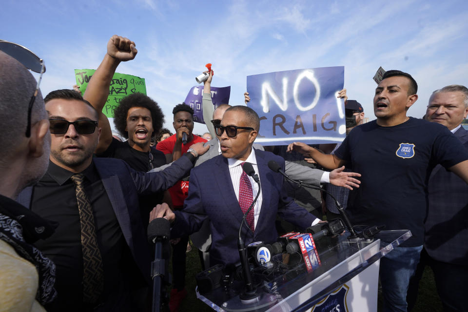 James Craig, a former Detroit Police Chief, announces he is a Republican candidate for Governor of Michigan amongst protesters on Belle Isle in Detroit, Tuesday, Sept. 14, 2021. (AP Photo/Paul Sancya)