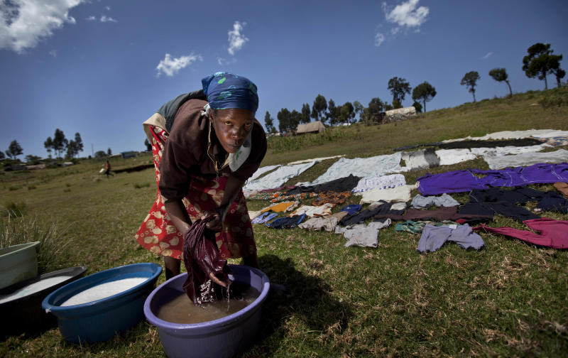 In this Sunday Feb. 10, 2013 photo, a displaced woman washes clothes at Mawingu camp for internally-displaced Kenyans from the Kikuyu tribe, near Ol Kalou, in Kenya. Weeks of violence left more than 1,000 people dead and forced hundreds of thousands of people to flee from their homes following a dispute over the December 2007 presidential vote and people are still afraid to go home and living in camps. Kenya holds another high-tension election next Monday without having fully solved the plight of hundreds of thousands of victims from the previous poll. Many say they are too traumatized to return to their homes even today, rights groups and refugee officials say. (AP Photo/Ben Curtis)