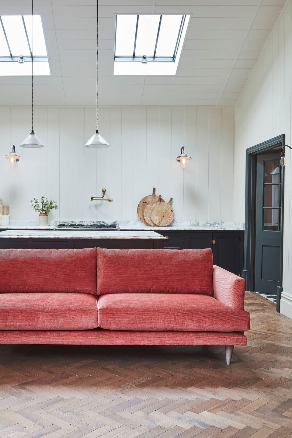 """<p>Red sofas can uplift moodier colour palettes used throughout a room, such as dark walls or deep mahogany floors. A sophisticated upholstery, such as a plush velvet or two-toned wool, offsets any risk of your reds appearing too bright or garish. </p><p>Pictured: <a href=""""https://go.redirectingat.com?id=127X1599956&url=https%3A%2F%2Fwww.darlingsofchelsea.co.uk%2Fmiddleton-range&sref=https%3A%2F%2Fwww.housebeautiful.com%2Fuk%2Fdecorate%2Fliving-room%2Fg37418005%2Fmost-popular-sofa-colours%2F"""" rel=""""nofollow noopener"""" target=""""_blank"""" data-ylk=""""slk:Middleton Sofa at Darlings of Chelsea"""" class=""""link rapid-noclick-resp"""">Middleton Sofa at Darlings of Chelsea</a></p>"""