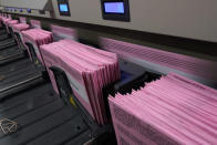 Mail in ballots run through a sorting machine at the Sacramento County Registrar of Voters office in Sacramento, Calif., Monday, Aug. 30, 2021. California voters have until Sept. 14 to cast their ballots to either keep Gov. Gavin Newsom in office are replace him with one of over 40 candidates on the recall ballot. In a state dominated by Democrats the outcome will depend on who takes the time to vote. (AP Photo/Rich Pedroncelli)