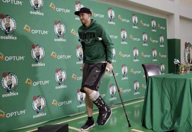 Gordon Hayward uses his crutches to leave his news conference Thursday. (AP)