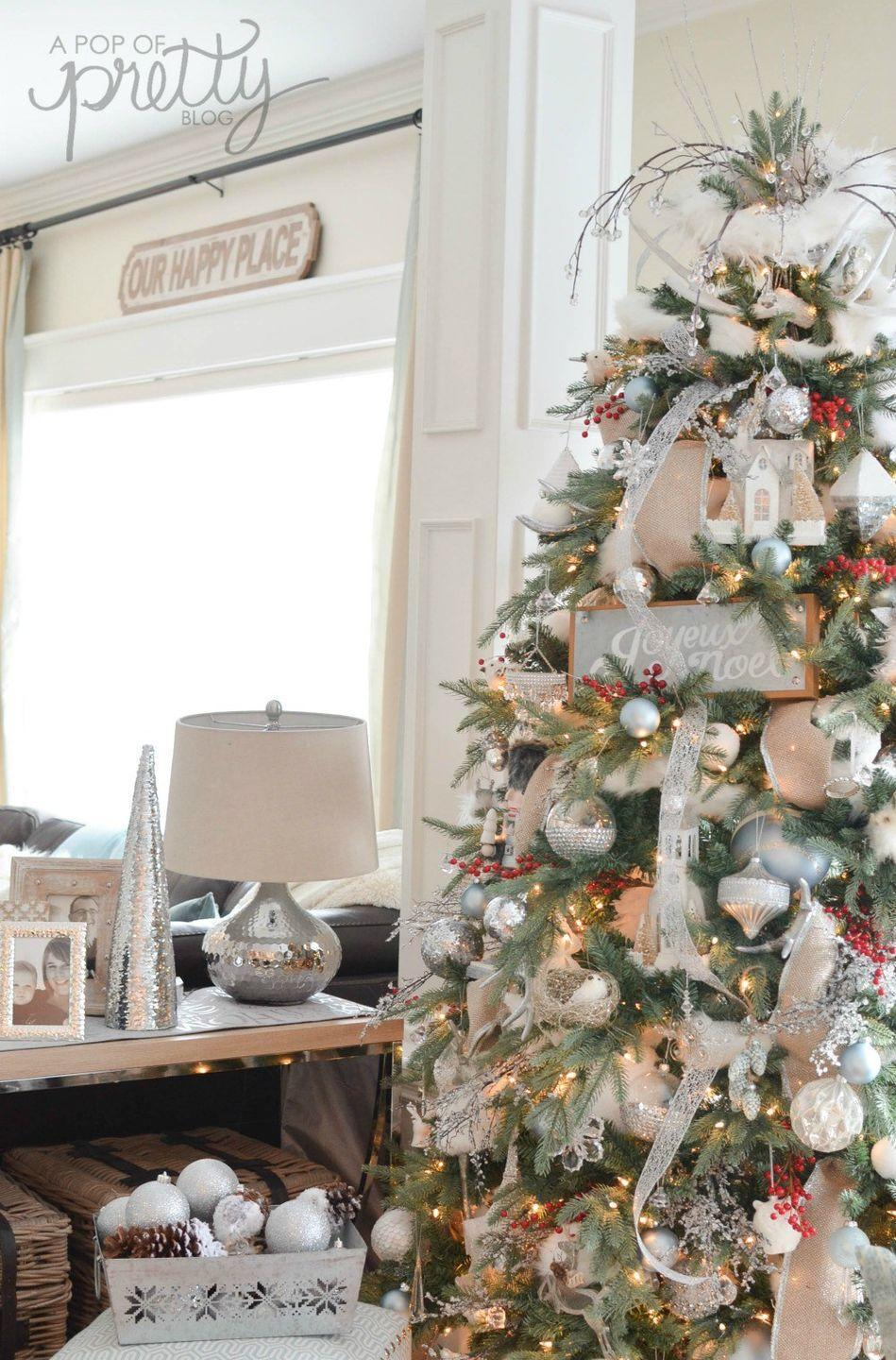 """<p>If you're overwhelmed with red and green but you still want to keep the Christmas spirit, add small bunches of red holly to this elegant tree.</p><p><strong><em>Get the tutorial at <a href=""""https://apopofpretty.com/canadian-bloggers-2016-christmas-tour-winter-wonderland/"""" rel=""""nofollow noopener"""" target=""""_blank"""" data-ylk=""""slk:A Pop of Pretty"""" class=""""link rapid-noclick-resp"""">A Pop of Pretty</a>.</em></strong></p><p><a class=""""link rapid-noclick-resp"""" href=""""https://www.amazon.com/Lvydec-Pack-Artificial-Berry-Stems/dp/B07YFKTLBG?tag=syn-yahoo-20&ascsubtag=%5Bartid%7C10070.g.2025%5Bsrc%7Cyahoo-us"""" rel=""""nofollow noopener"""" target=""""_blank"""" data-ylk=""""slk:BUY HOLLY BERRIES"""">BUY HOLLY BERRIES</a> </p>"""
