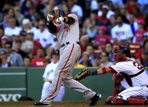 Baltimore Orioles' Manny Machado, left, hits an RBI single off a pitch by Boston Red Sox's Felix Doubront as Baltimore Orioles catcher Matt Wieters, right, looks on in the fifth inning of a baseball game at Fenway Park, in Boston, Sunday, Sept. 23, 2012. (AP Photo/Steven Senne)