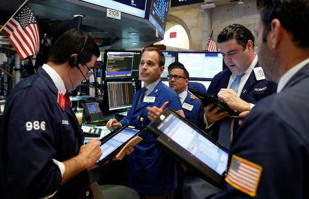 Traders work on the floor of the New York Stock Exchange (NYSE) in New York City,