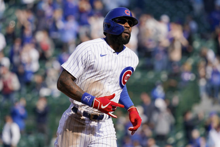 Chicago Cubs' Jason Heyward runs the bases after hitting a solo home run during the eighth inning of the team's baseball game against the Milwaukee Brewers in Chicago, Saturday, April 24, 2021. The Brewers won 4-3. (AP Photo/Nam Y. Huh)