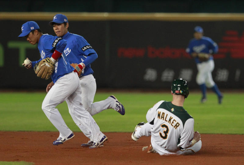Australia's first baseman Mike Walker (3) is forced out at second base by Korea's second baseman Jeong Keunwoo, left,  and shortstop Kang Jungho in the first inning of their World Baseball Classic first round game at the Intercontinental Baseball Stadium in Taichung, Taiwan, Monday, March 4, 2013. (AP Photo/Wally Santana)
