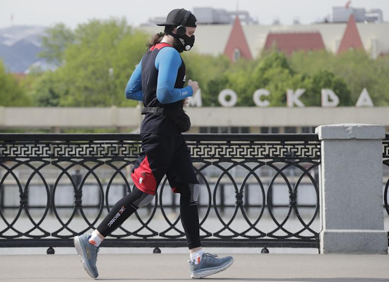 MOSCOW, RUSSIA - MAY 27, 2020: A man jogs by the Moskva River amid the ongoing COVID-19 pandemic. The self-isolation regime in Russia is extended until 31 May in order to prevent the spread of the novel coronavirus. Mikhail Metzel/TASS (Photo by Mikhail Metzel\TASS via Getty Images)