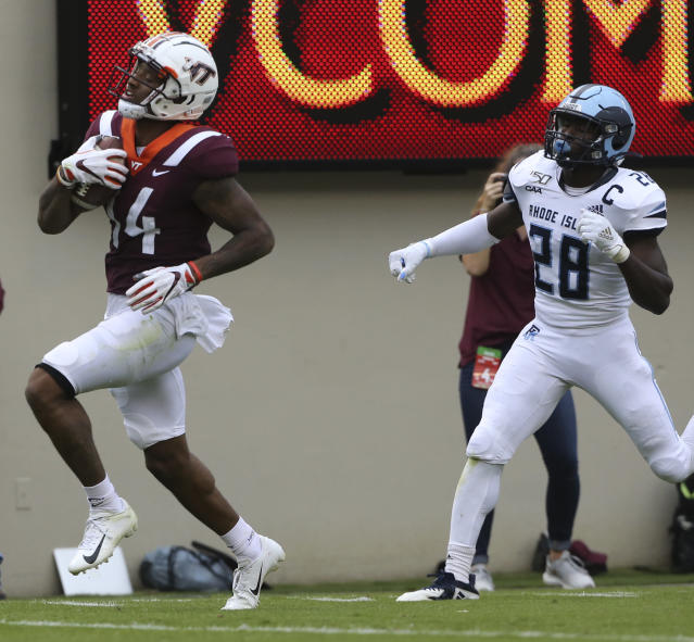 Damon Hazelton (14) of Virginia Tech scores past Momodou Mbye (28) of Rhode Island in the first half of an NCAA college football game in Blacksburg Va., Saturday, Oct. 12 2019. (Matt Gentry/The Roanoke Times via AP)