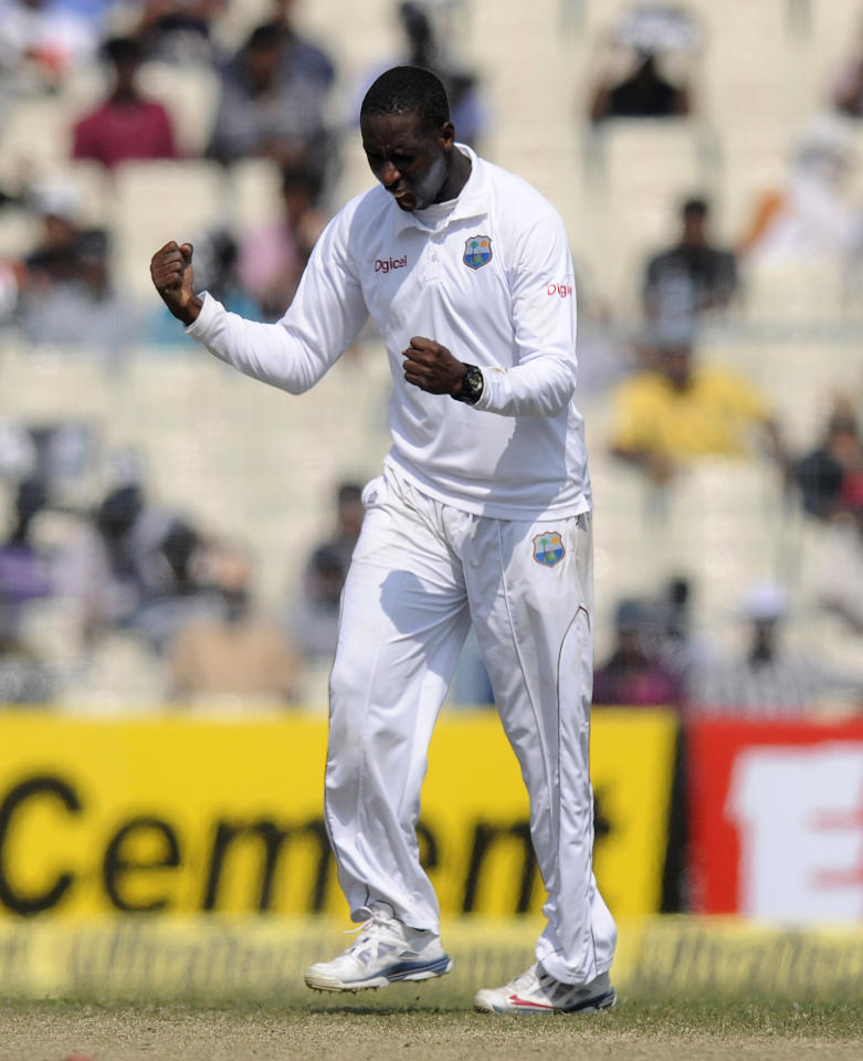Shane Shillingford of West Indies celebrates the wicket of Ravichandran AShwin of India during day three of the first Star Sports test match between India and The West Indies held at The Eden Gardens Stadium in Kolkata, India on the 8th November 2013  Photo by: Pal Pillai - BCCI - SPORTZPICS