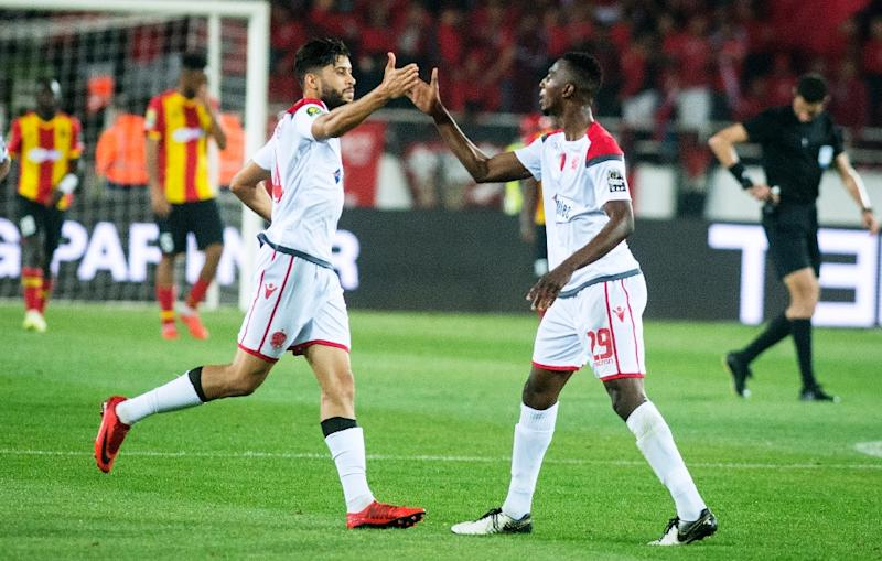 Wydad and Esperance meet again next Friday in the Tunis suburb of Rades to decide who wins the elite African club competition and becomes $2.5 million (about 2.2 mn euro) richer (AFP Photo/FADEL SENNA)