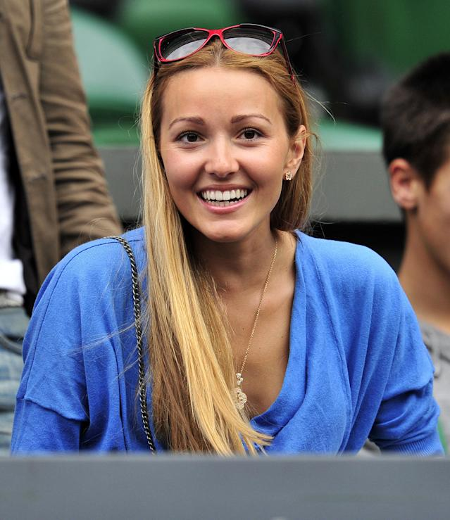 Jelena Ristic, partner of Novak Djokovic smiles during the men's single final between Spanish player Rafael Nadal and Serbian player Novak Djokovic at the Wimbledon Tennis Championships at the All England Tennis Club, in southwest London on July 3, 2011. AFP PHOTO / GLYN KIRK RESTRICTED TO EDITORIAL USE (Photo credit should read GLYN KIRK/AFP/Getty Images)