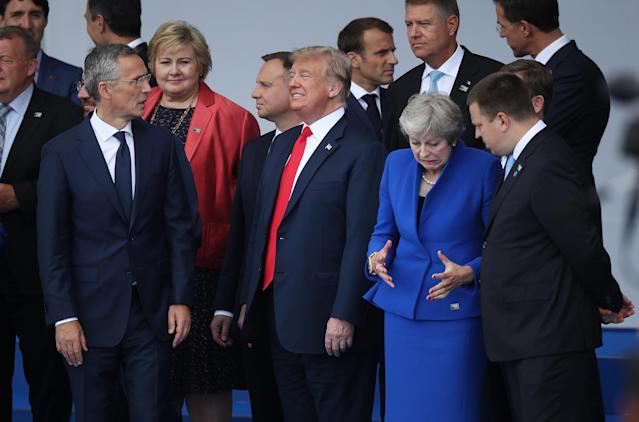 <p>Front row from left: NATO Secretary-General Jens Stoltenberg, President Trump and British Prime Minister Theresa May attend the opening ceremony at the 2018 NATO summit on July 11, 2018, in Brussels. (Photo: Sean Gallup/Getty Images) </p>