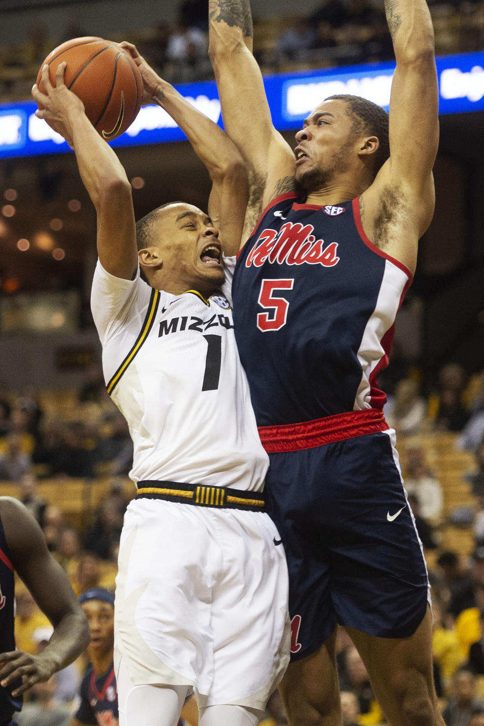 Missouri's Xavier Pinson, left, is fouled by Mississippi's KJ Buffen, right, as he shoots during the second half of an NCAA college basketball game Tuesday, Feb. 18, 2020, in Columbia, Mo. Missouri won 71-68.(AP Photo/L.G. Patterson)