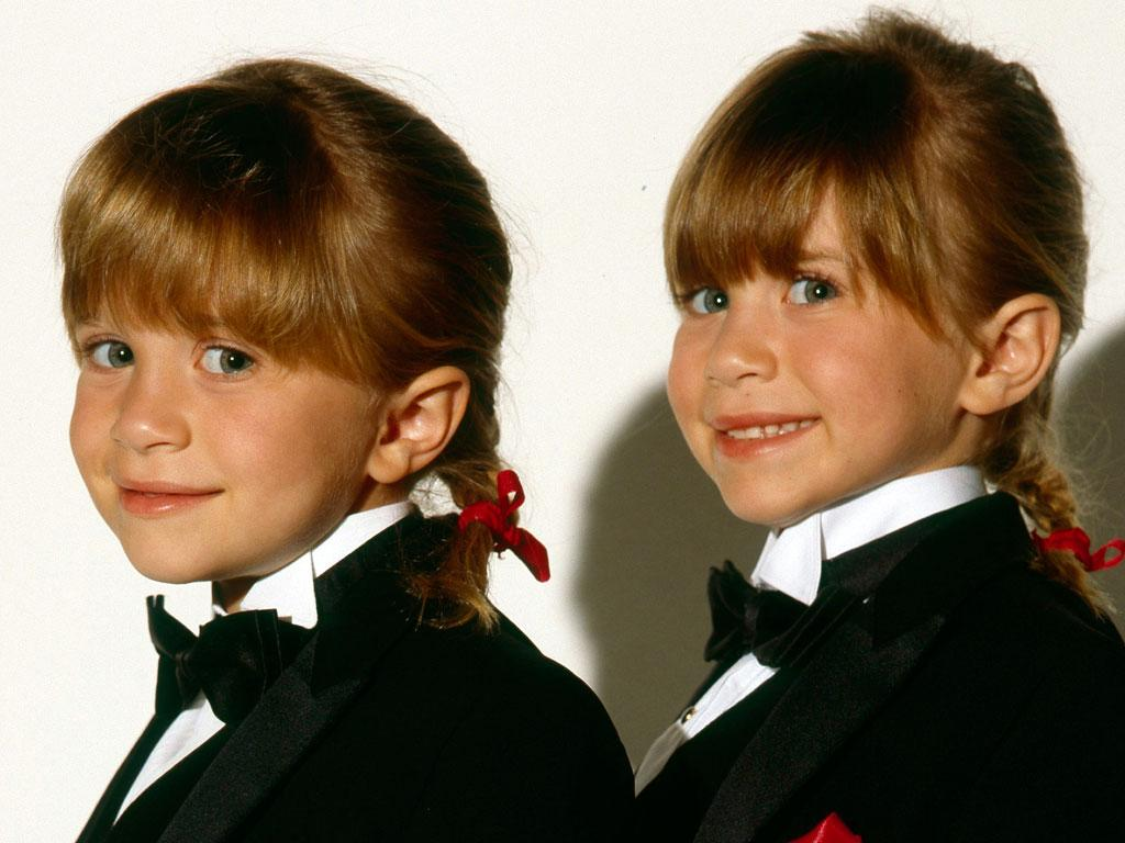 "Observant fans could tell whether it was Mary-Kate or Ashley appearing in any given scene. Although they are very similar looking, they are not actually identical. The fraternal twins have a few <a href=""http://www.people.com/people/mary-kate_olsen/0,,,00.html"">differences</a>. Mary-Kate is left-handed and Ashley is a righty. Plus, Ashley has a freckle above her lip."