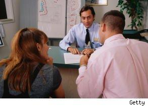 Picture shows couple applying for a home loan with their mortgage broker, hoping to pick the right mortgage.