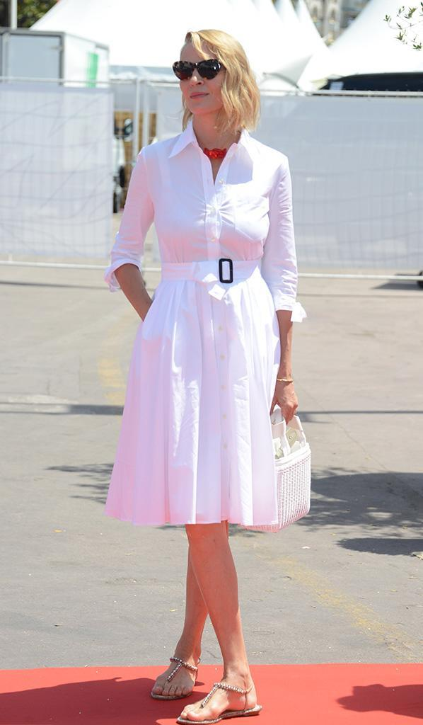 <p>Her lunch look here on May 21 was light and lively. She stood out in the crisp white belted dress while rocking shades and holding a white purse. (Photo: Manuele Mangiarotti/SilverHu/REX/Shutterstock)<br><br></p>
