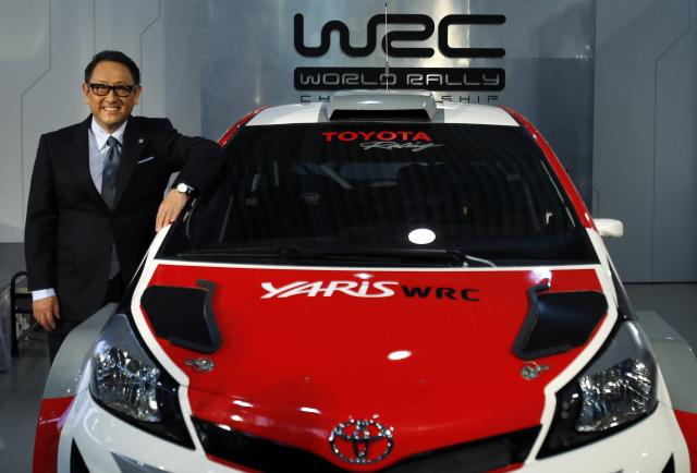 "Toyota Motor Corp President Akio Toyoda poses for pictures next to the ""Yaris WRC"", a vehicle being developed for the FIA World Rally Championship (WRC) during a news conference to announce its return to WRC in 2017, in Tokyo January 30, 2015. REUTERS/Yuya Shino (JAPAN - Tags: SPORT MOTORSPORT BUSINESS)"