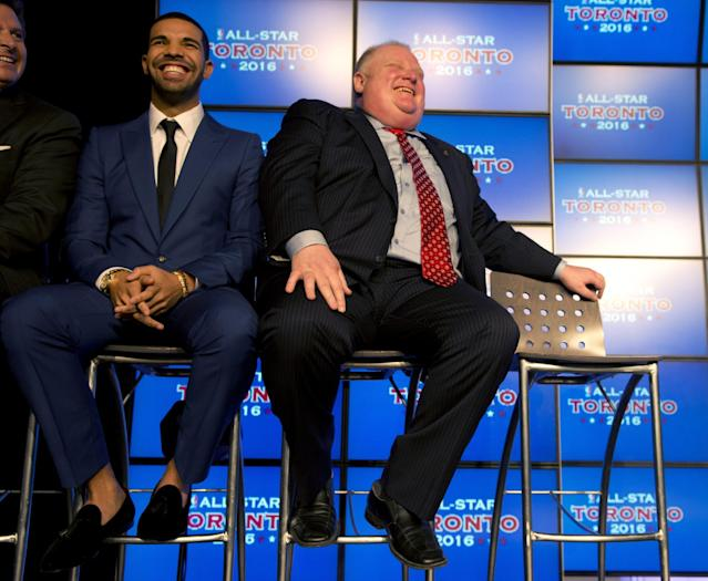 Canadian recording artist Drake, left, and Toronto Mayor Rob Ford listen to the announcement that the Toronto Raptors will host the 2016 NBA All Star game at a news conference in Toronto on Monday Sept. 30, 2013. (AP Photo/The Canadian Press, Frank Gunn)