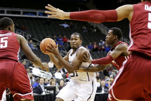 Texas A&M guard Elston Turner (31) looks to pass under pressure from Washington State's Junior Longrus (15), Mike Ladd (2) and Will DiIorio (5) during the first half of an NCAA college basketball game, Tuesday, Nov. 20, 2012, in Kansas City, Mo. (AP Photo/Charlie Riedel)
