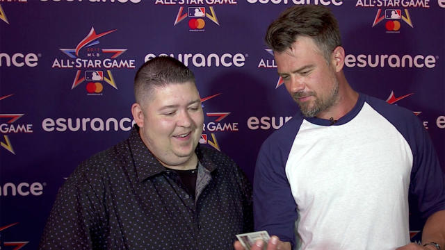Actor Josh Duhamel opening old baseball cards at the MLB All-Star Game. (Yahoo Sports)