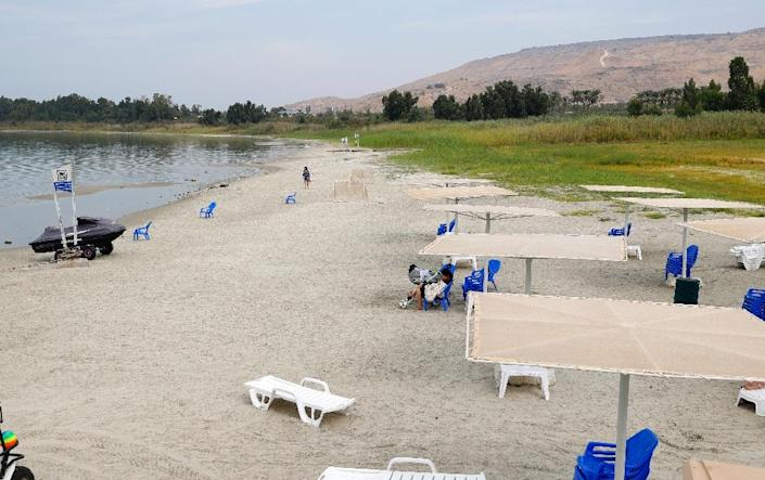 The Sea of Galilee has been shrinking for years, leading to the appearance of sandy spots at the water's edge (AFP Photo/JACK GUEZ)
