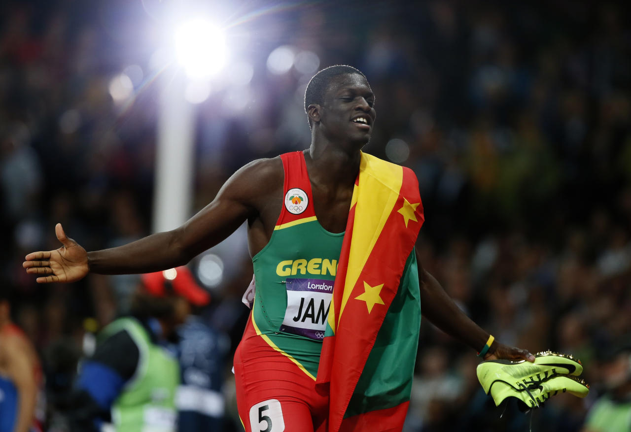 Grenada's Kirani James celebrates after winning the men's 400m final at the London 2012 Olympic Games at the Olympic Stadium August 6, 2012. REUTERS/Lucy Nicholson (BRITAIN  - Tags: OLYMPICS SPORT ATHLETICS)