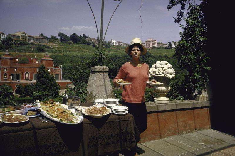 <p>Sophia Loren loads up at the buffet at her villa in the Italian countryside in 1964. The film star bought and renovated the 16th century home with her husband, Carlo Ponti, in 1954. </p>