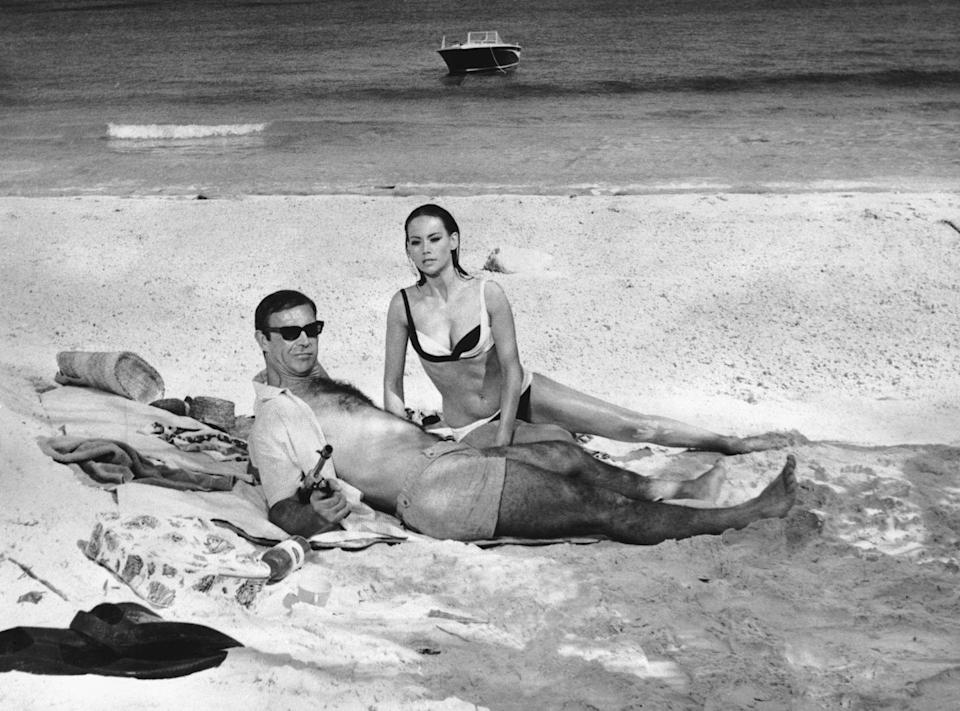 <p>Connery and Maryse Mitsuoko in the Bahamas in the most commercially successful Bond film, Thunderball, in 1965. </p>